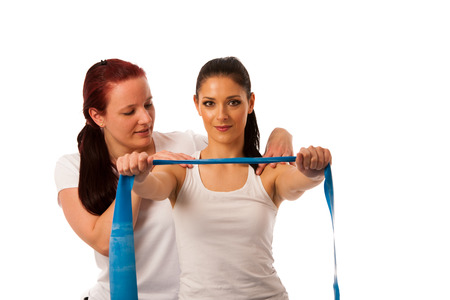 Physiotherapy - therapist doing arm strenghteninh excercises with a patient to recover strenght after injury Stock Photo