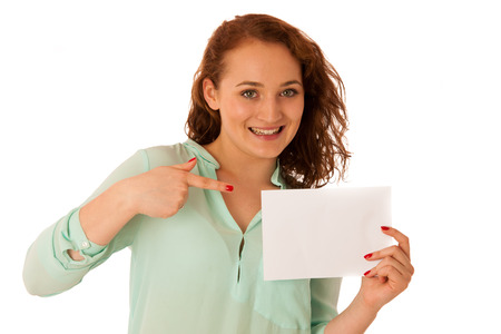copyspace: Sign board. Woman holding big white blank card. Positive emotional portrait of happy girl with long hair. Stock Photo