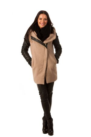 successes: Woman in winter coat standing confidently and smiling. Business woman prepared for winter successes. Stock Photo
