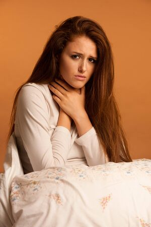 illness flu sore throat woman resting in bed Stock Photo