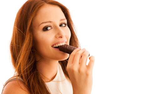 woman eating chocolate bar isolated over white background