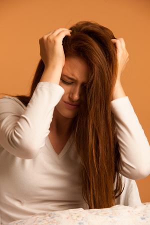 illness woman having headache and feeling unweal