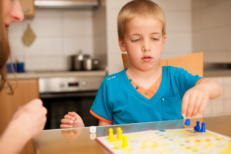 ludo: kid plays ludo game Stock Photo