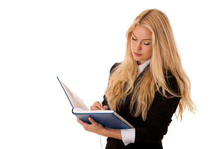 business woman writing notes in her notebook isolated over white.
