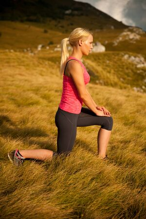 lunge: Women workout in nature making a lunge step
