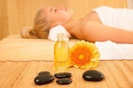 enyoing: Beautiful blonde woman enyoing massage treatment in sap salon