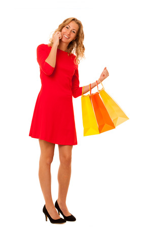 Cutwe brunette woman with curly brown hair holding shopping bags answering the phone  isolated over white