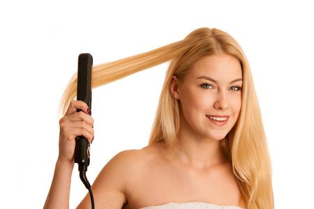 hait: Woman straighten her hait isolated over white background