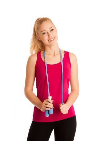 loose hair: Fit woman with speed rope isolated over white background