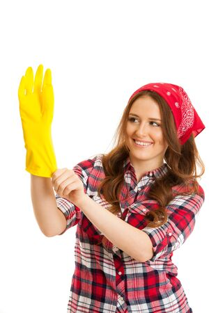 Cute young woman in checkered shirt with yellow rubber gloves ready for work