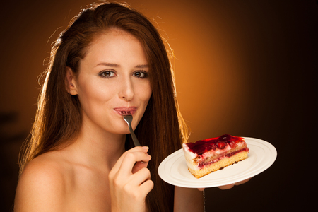 strawberry cake - wman eats sweet dessert isolated