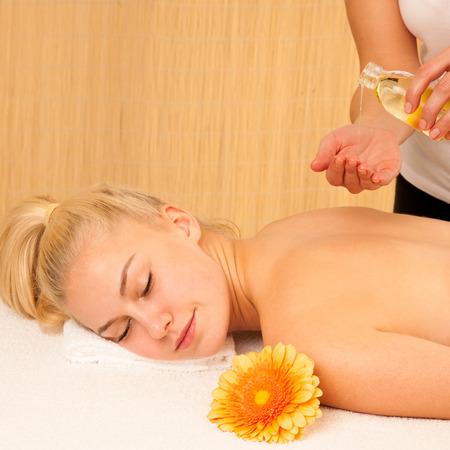 Beautiful blonde woman enyoing massage treatment in sap salon