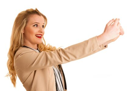 Beautiful young woman taking selgfie photo with smartphone isolated Stock Photo