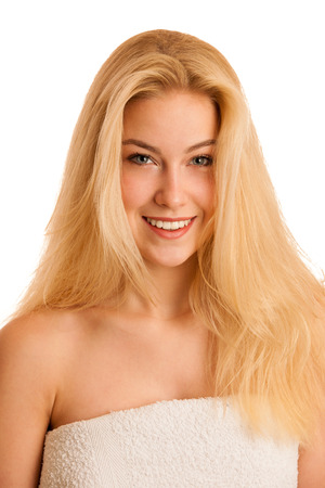 Beautiful blonde woman wrapped in towel after bath isolated over white background Stock Photo