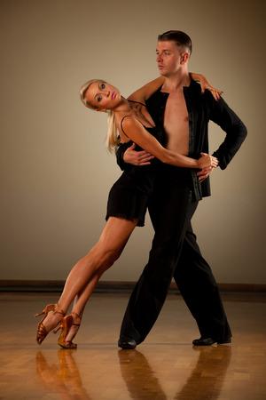 Beautiful ballroom couple preforming their pasonate exhibition dance