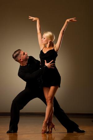 Beautiful ballroom couple preforming their pasonate exhibition dance Stock Photo - 76932183
