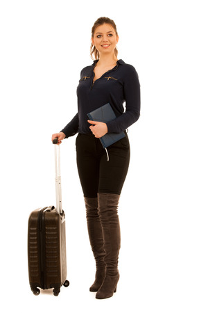 young woman with suit case traveling isolated over white - full lenght photo