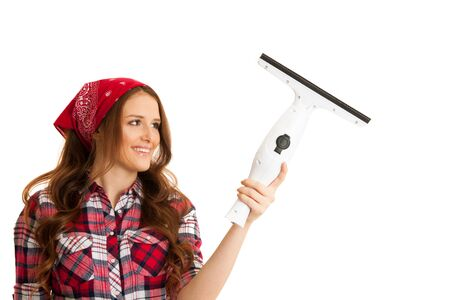 Happy young woman cleaning windows isolated over white vackground