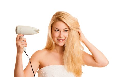 bathroom tiles: Blonde woman drieing her hair with air blower isolated over white