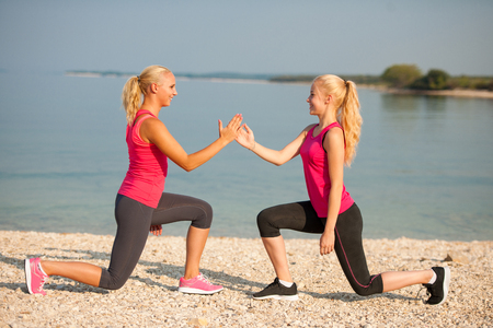 women workout doing lunge step on beach