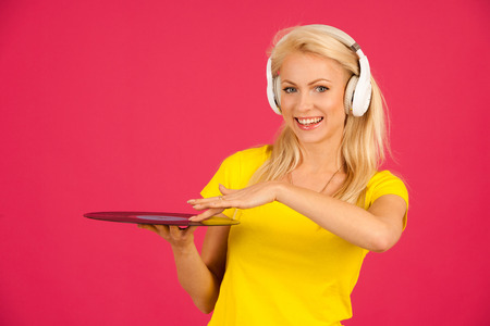 sexy girl dance: Beautiful young blond woman listening music over vibrant color background