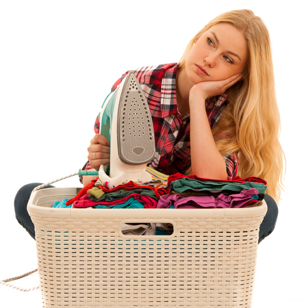 tired woman with a basket of loundry annoyed with too much work