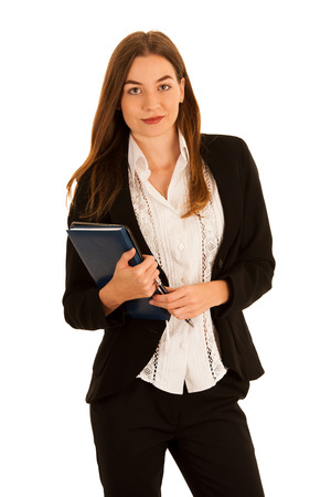 Attractive beautiful busienss woman with notebook and folder isolated over white background Stock Photo
