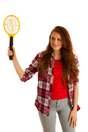 electric grid: attractive Beautiful young woman holds electroc racket for kiling flys