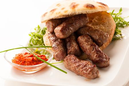 photo of Cevapi, cevapcici, traditional  Balkan food - delicius minced meat