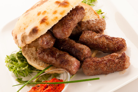 photo of Cevapi, cevapcici, traditional  Balkan food - delicius minced meat Stock Photo - 85007703