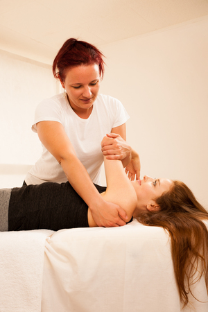 physiotherapy -therapist exercising with patient , working on arm stretching
