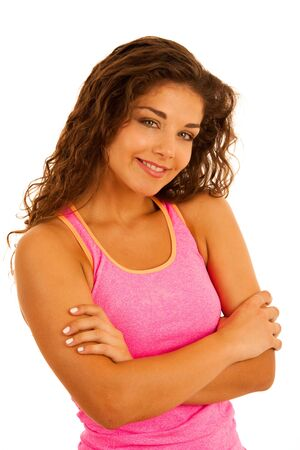 Active young woman with arms crossed isolated over white background
