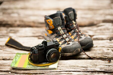 Shoes camera and map trekking accessories