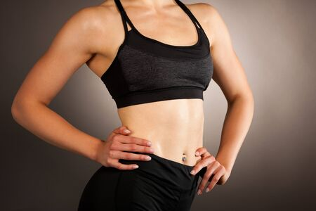 Active young fit woman with perfect body pose Stock Photo