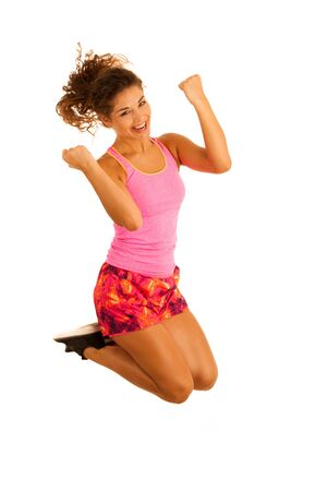 active excited fit woman jumps over white background