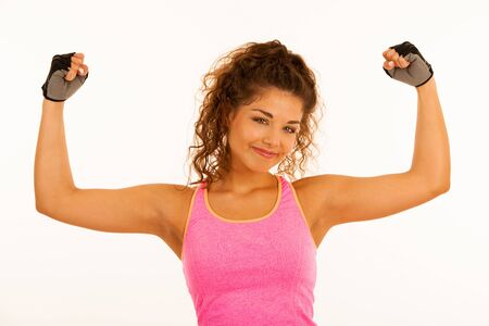 Active young sporty fit woman gesture power with her arms up isolated over white