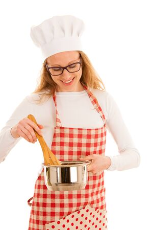 Beautifulyoung  chef cooking studio isolated over white background