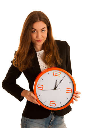 Young business woman holding a clock isolated over white - time management conceptual hpoto Stock Photo