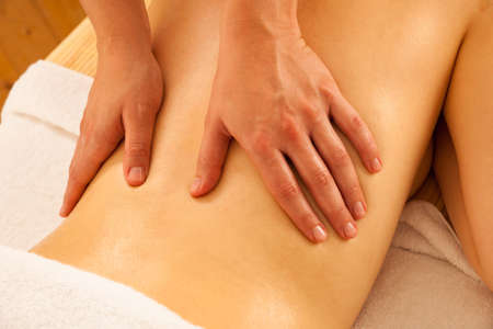 Body care. Spa body massage treatment. Woman having massage in the spa salon Stock Photo