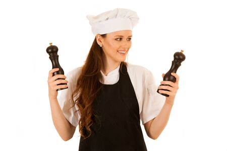 Beautiful chef woman holding salt and pepper grinder isolated over white background Stock Photo