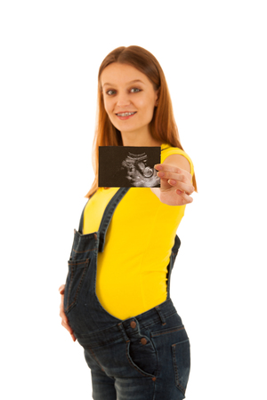 Beautiful pregnant woman show with ultrasound baby on white background