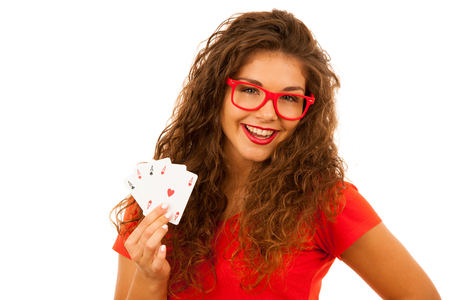 Beautiful young woman holds poker cards four aces isolated over white background Stock Photo