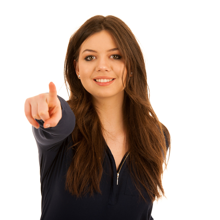 attractive young woman pointing to copy space isolated over white background