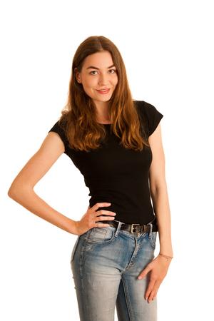 Séduisante jeune femme en jeans et t shirt noir isolé sur fond blanc Banque d'images - 90707570