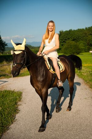 Active young woman ride a horse in nature 版權商用圖片