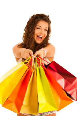 Attractive young caucasian woman with shopping bags isolated over white background Stock Photo