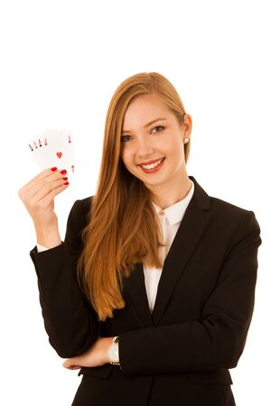 Beautiful woman showing for aces as a gesture of poger game - gambling in casino isolated over white background