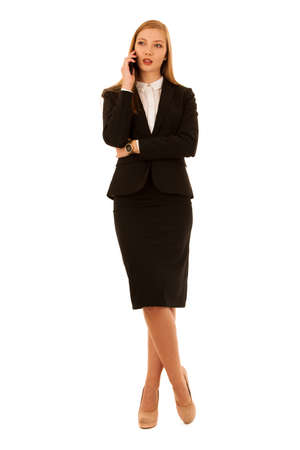 Full length portrait of business woman talking on phone isolated over white background Stock Photo