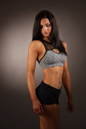 Beautiful young hispanic fit sporty woman studio portrait Stock Photo