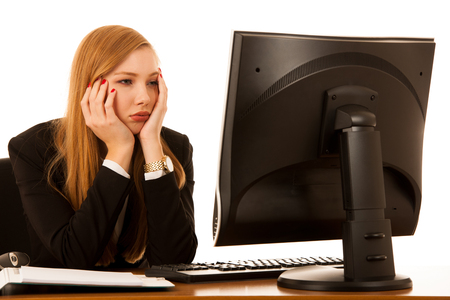 Stressed anxious business woman stare in monitor in her office